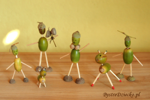 Little forest people made from acorns during art projects for kids