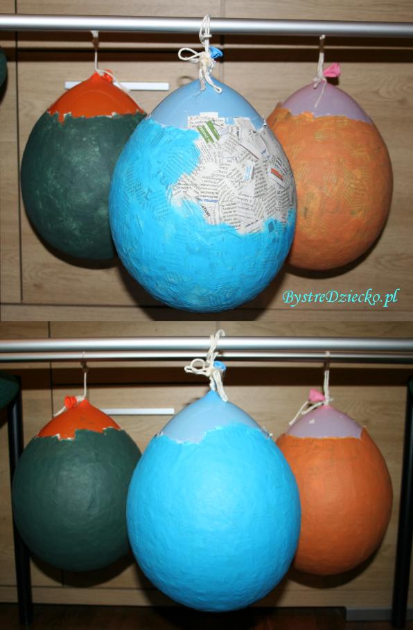 Jaja dinozaura lub gigantyczne jajka wielkanocne z papier mache wykonane w ramach prac plastycznych dla dzieci - kolorowe pisanki wielkanocne