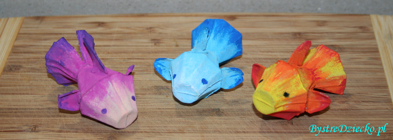 Colorful egg carton fish made from recycled materials during activities for kids